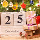 Free Download Date 25 December, gifts with sled and christmas tree with decoration, festive time concept Nulled