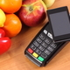 Free Download Payment terminal and smartphone with NFC technology, fruits and vegetables Nulled