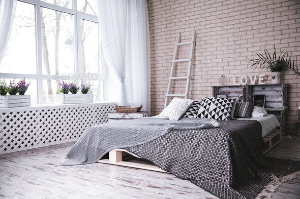 Modern Bedroom With Comfortable Double Bed And Stylish White Brick Wall Stock Photo By Serbogachuk
