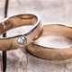 Free Download old Wedding rings on wooded background Nulled