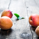 Free Download Fresh apricots on wooden background. fruit Nulled