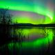 Intense Aurora borealis reflection Lake Laberge Yukon Canada - PhotoDune Item for Sale
