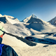 Mountain trekker in high snowed mountains looking in the distance, Himalayas - PhotoDune Item for Sale