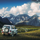 Landscape view of mountain range and offroad car in the meadow, Svaneti, Country of Georgia - PhotoDune Item for Sale