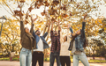 Friends having fun throwing leaves in the air - PhotoDune Item for Sale