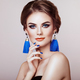 Beautiful Woman with Large Earrings Tassels - PhotoDune Item for Sale