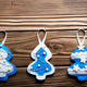 Handmade rustic felt Christmas tree decorations on wooden table - PhotoDune Item for Sale