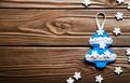 Handmade rustic felt Christmas tree decorations on wooden table - PhotoDune Item for Sale
