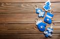 Handmade rustic felt Christmas tree decorations flat laying on w - PhotoDune Item for Sale