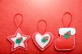 Handmade rustic Christmas tree decorations on red felt backgroun - PhotoDune Item for Sale