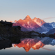 Colourful sunset on Lac Blanc lake in France Alps - PhotoDune Item for Sale