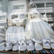 Free Download Dresses and shoes to make first communion reflected in showcase, conceptual image Nulled