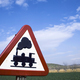 Free Download Warning sign worn of level crossing without barriers, blue sky with clouds Nulled