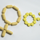 Free Download Symbol male and female formed with pills yellow Nulled