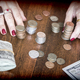 Free Download Women counting banknotes of dollar and some coins on a table, conceptual image Nulled