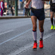 Marathon running race, runners running on city roads, detail on legs - PhotoDune Item for Sale