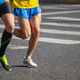Free Download Marathon running race, two men runners on city roads, detail on legs, Nulled