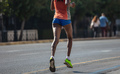 Running in the city roads. Young woman runner, back view, blur background - PhotoDune Item for Sale