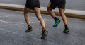 Marathon running race, two runners on city roads, detail on legs - PhotoDune Item for Sale