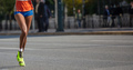 Running in the city roads. Young woman runner, front view, banner, blur background - PhotoDune Item for Sale