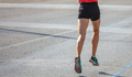 Running in the city roads. Young man runner, back view, blur background, copy space - PhotoDune Item for Sale