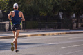 Running in the city roads. Young man runner, back view, blur background - PhotoDune Item for Sale
