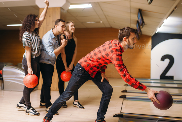 Male bowler throws ball, throwing in action - Stock Photo - Images