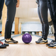 Free Download Bowling team, feet in house shoes and ball on lane Nulled