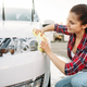 Free Download Female person with sponge cleans vehicle headlight Nulled