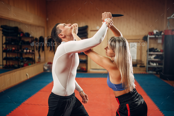 Woman makes punch to the throat, self-defense - Stock Photo - Images