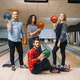 Free Download Bowling team poses on lane with balls on hands Nulled