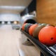 Free Download Color bowling balls in feeder, bowl game concept Nulled