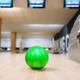 Green bowling ball on wooden floor in club - PhotoDune Item for Sale