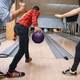 Free Download Male bowler on lane prepares to throw a ball Nulled