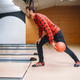 Free Download Bowler makes throw, closeup view on hand with ball Nulled