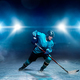 Free Download One hockey player on ice, spotlights on background Nulled