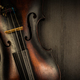 Free Download Detail of old violin in vintage style on wood background Nulled