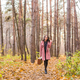 Fall, season and people concept - young woman walking in park at autumn - PhotoDune Item for Sale