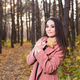 People, season and style concept - beautiful young woman smiling in autumn park - PhotoDune Item for Sale