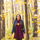 Young funny woman throwing leaves in autumn park - PhotoDune Item for Sale