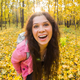 April fools day concept - portrait of funny smiling woman in autumn forest - PhotoDune Item for Sale