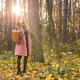 Fall, season and people concept - charming woman standing in park at autumn - PhotoDune Item for Sale