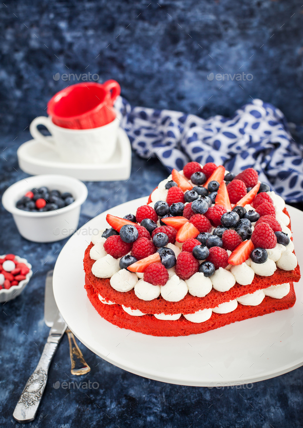 Delicious homemade heart shaped red velvet cake decorated with c - Stock Photo - Images