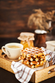 Breakfast with belgian waffles, jam and coffee on tray, rustic b - PhotoDune Item for Sale