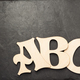 wooden letters on slate stone - PhotoDune Item for Sale
