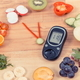 Glucose meter showing sugar level, fruits and vegetables in shape of clock - PhotoDune Item for Sale