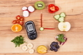 Glucometer with result of sugar level and clock made of fruits with vegetables - PhotoDune Item for Sale