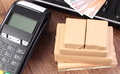 Payment terminal, currencies euro, laptop and wrapped boxes on wooden pallet - PhotoDune Item for Sale