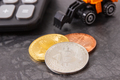 Bitcoin coins with calculator and miniature excavator - PhotoDune Item for Sale