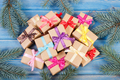 Wrapped gifts with ribbons for Christmas and spruce branches - PhotoDune Item for Sale